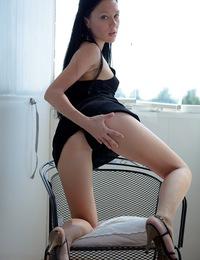 Adorable brunette pleasures damp cooch with her fingers