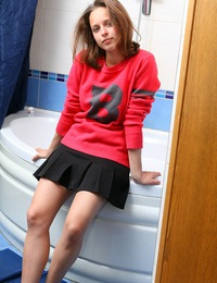 A horny girl washing her cute teenage titties in the tub