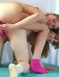 Two handsome teenage lesbians enjoying a very long dildo