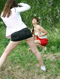Teen cutie photographing her sexy naked friend outdoors